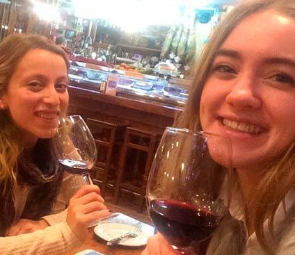 Two girls drinking wine