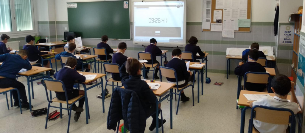 Students taking an exam in class
